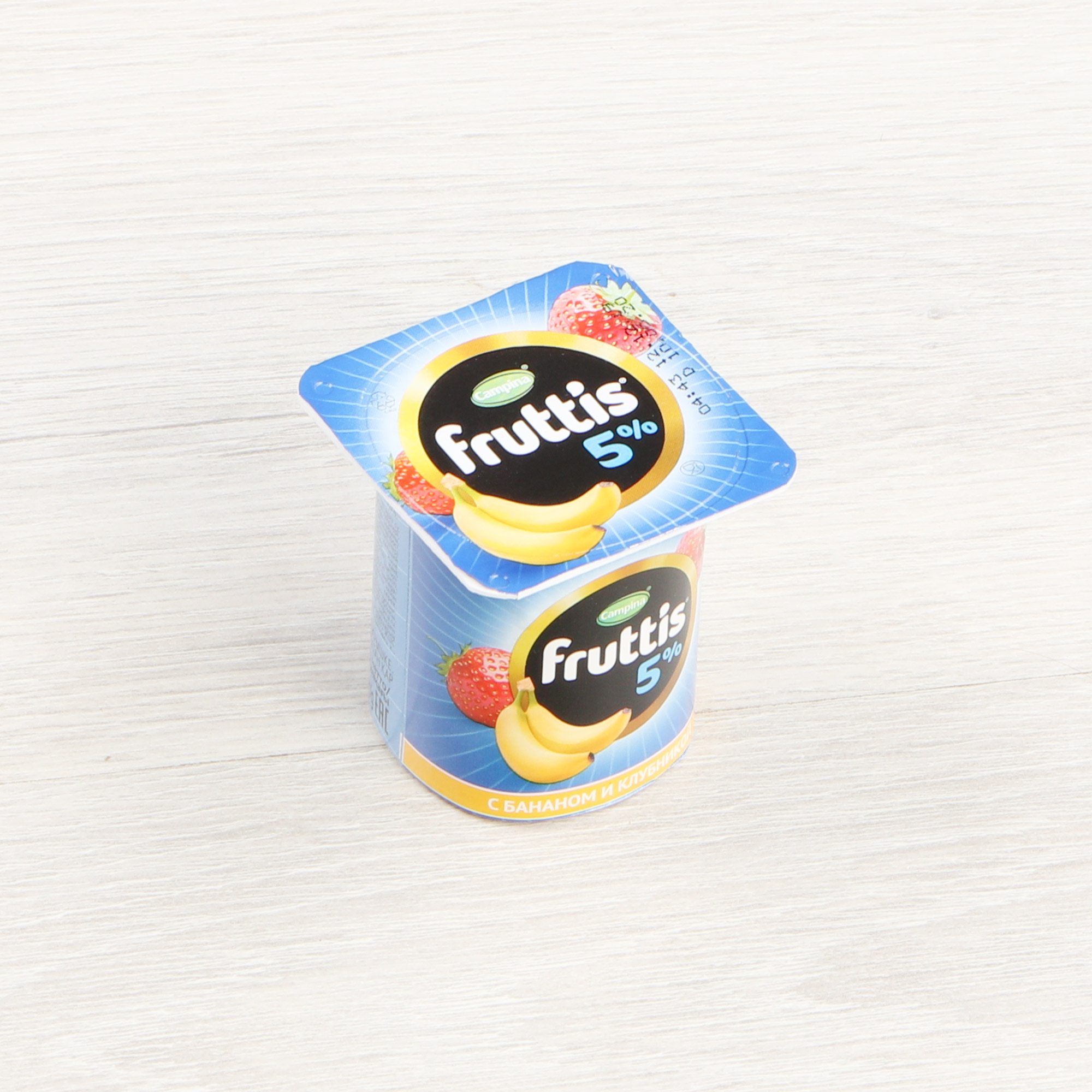 Фото - Йогурт Campina Fruttis Дыня, манго, банан, клубника 5% 115 г йогурт campina fruttis легкий клубника 0 1% 110 г